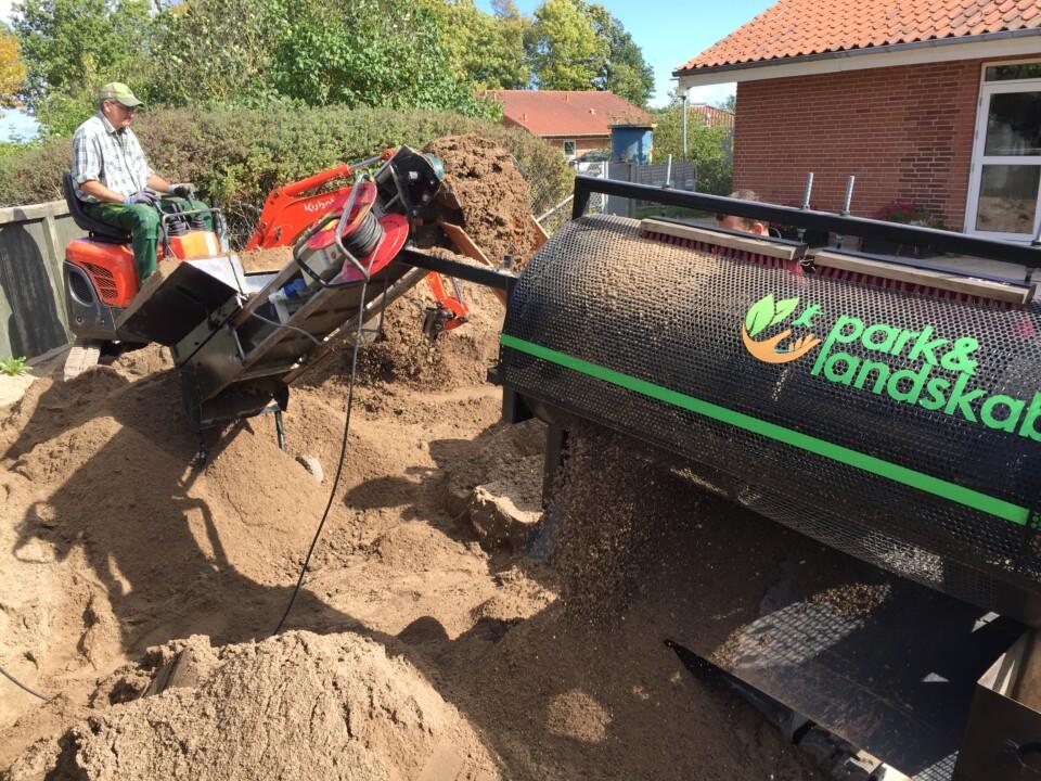 Vores maskine til rensning af sandkasser og faldunderlag